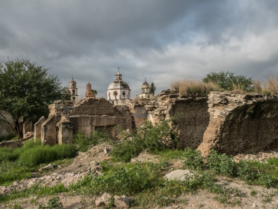 I could believe my luck when i found the ruins in the foreground with an angry sky in the background. Buttresses of an old church are evident on the left side of the photo.