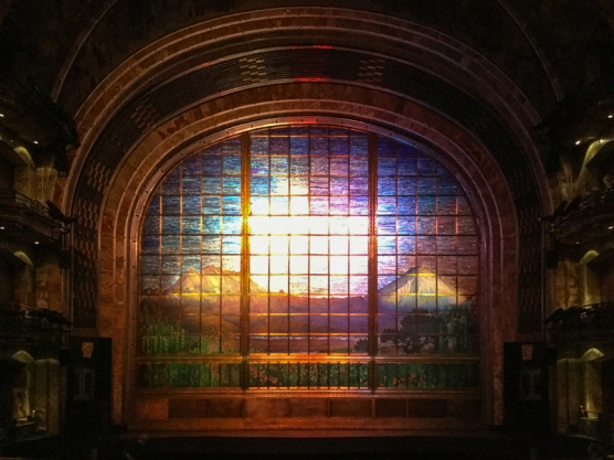 """The """"curtain"""" is a stained glass foldable panel created out of nearly a million pieces of iridescent colored glass by Tiffany's...weighs 24 tons."""