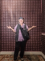 Chris in a room with chocolate wallpaper. She likes Mexican chocolate, I don't.