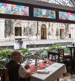 Chris in a restaurant across the street from the Iglesia de la Merced