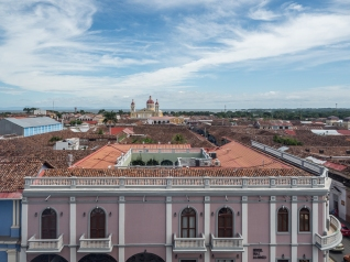 Restored building with the Catedral de Granada in the distance